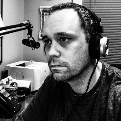 Black and white image of Casey Boyle wearing headphones