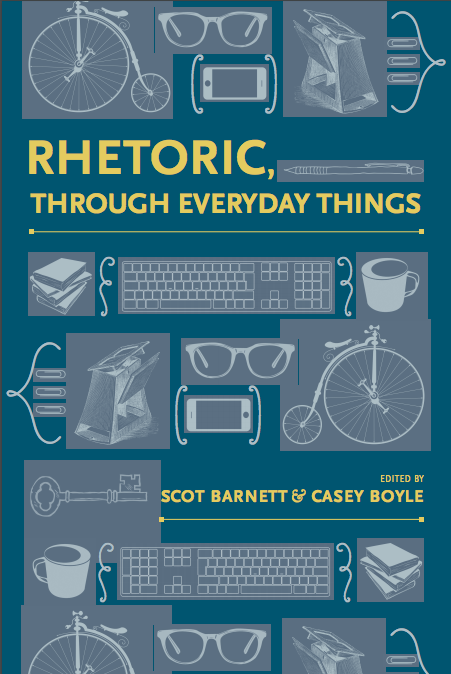 "Book Cover showing assembled ""things"": metronome, 18th century bicycle, iphone, glasses, keyboard, stack of books, paperclips, coffee cup, old key"