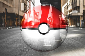 Red and White Pokemon Ball Super imposed on an image of legs standing on a street